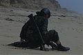 A Japan Ground Self-Defense Force soldier adjusts his gear after arriving on the beach during helocast training during Dawn Blitz 2013 at Camp Pendleton, Calif., June 6, 2013 130606-M-QH793-106.jpg