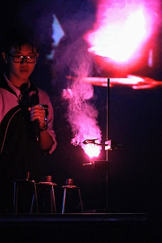 Flame test - A flame test showing the presence of Lithium.