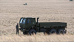 A U.S. Airman with the 726th Air Control Squadron (ACS) inspects his truck during a convoy halt in the Idaho desert, roughly 75 miles from Mountain Home Air Force Base in Idaho, Oct. 4, 2013, during Mountain 131004-F-WU507-017.jpg