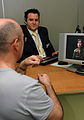 A Video Relay Service session helping a Deaf person communicate with a hearing person via a Video Interpreter (sign language interpreter) and a videophone DSC 0080.JPG
