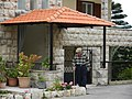 A man walking out his house in Ejdabrine, Koura, Lb.jpg