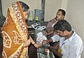 A polling official administering indelible ink to a voter, at a polling booth, during the fifth phase of West Bengal Assembly Election, at Bhawanipur constituency of Kolkata South on April 30, 2016.jpg