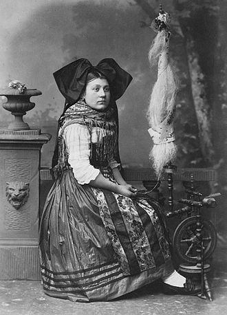 Alsace - An Alsatian woman in traditional costume, photographed by Adolphe Braun