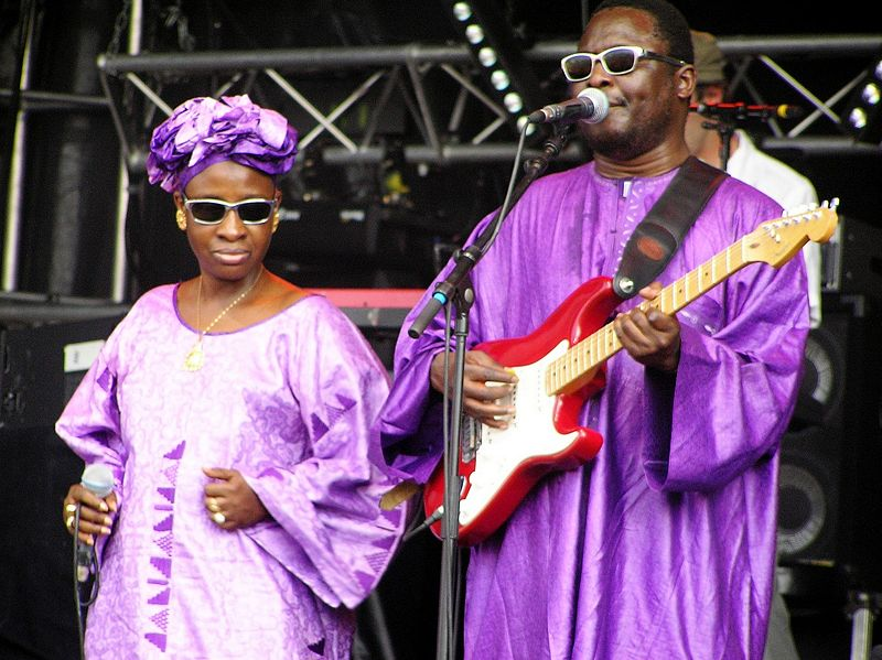 Musicians Amadou and Mariam onstage in purple outfits