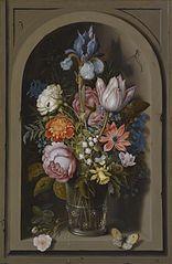 A still life of flowers in a glass beaker