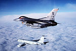 An air-to-air left side view of a 50th Tactical Fighter Wing F-16C Fighting Falcon aircraft flying alongside a KC-135R Stratotanker before refueling DF-ST-87-13146.jpg