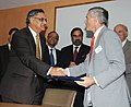 Anand Sharma and the Secretary of State for Business, Innovation and Skills, UK, Dr. Vincent Cable witnessing the exchanging of the signed documents of an MoU between Invest India & UKTI, in New Delhi on July 29, 2010.jpg