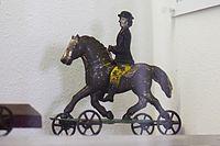 Antique toy lady on horseback (24434351633).jpg