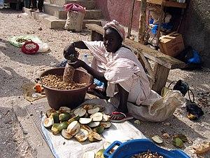Agriculture in Senegal - A Peanut seller in Joal-Fadiouth, Senegal.