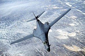 A B-1B Lancer with wings swept full forward