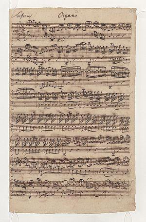 Wir danken dir, Gott, wir danken dir, BWV 29 - First page of the autograph manuscript of the organ obbligato part in the opening Sinfonia