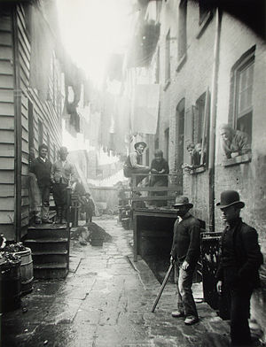 "Mulberry Street (Manhattan) - ""Bandit's Roost"", a Mulberry Street back alley, photographed by Jacob Riis in 1888, a target of police efforts in the 1880s and 1890s"
