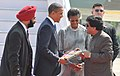 Barack Obama and the First Lady Mrs. Michelle Obama being presented a book by the Chief Minister of Maharashtra, Shri Ashok Chavan on their arrival, at Chhatrapati Shivaji International Airport, in Mumbai,.jpg