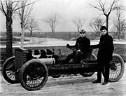 Ford (standing) launched Barney Oldfield's career in 1902