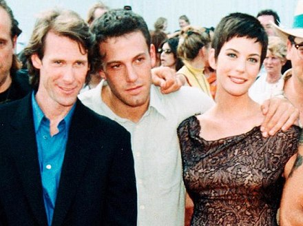 Affleck with Michael Bay and Liv Tyler at the Armageddon premiere in 1998 Bay Affleck Tyler at JFK Space Center Armageddon premiere (cropped).jpg