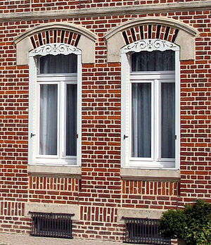Pelmet - External decorative pelmets fitted within a brick and stone window opening