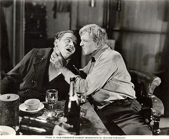 Hobart Bosworth - In a scene still for the 1919 silent drama Behind the Door, German U-boat commander Lieutenant Brandt (played by Wallace Beery) is being throttled by American Merchant Marine Captain Oscar Krug (Hobart Bosworth).