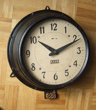 Peter Behrens - Industrial clock designed by Behrens for AEG in 1909