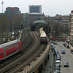 An S-Bahn train stops at Hackescher Markt station as a regional train passes in April 2006