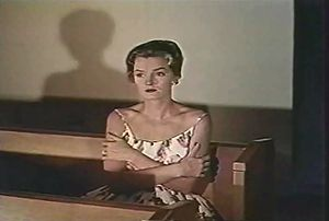 Last Woman on Earth - Evelyn in the church