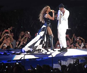 On the Run Tour (Beyoncé and Jay-Z) - During the tour, both headliners sported multiple outfits. Beyoncé is seen wearing a black and white American flag dress, with a 16.4 feet long train.