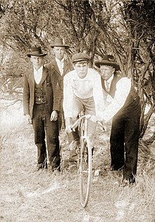 Bicycle circa 1896 with boy and three men.jpg