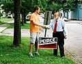 Bill Peirce with Sean and his yard sign (242586904).jpg