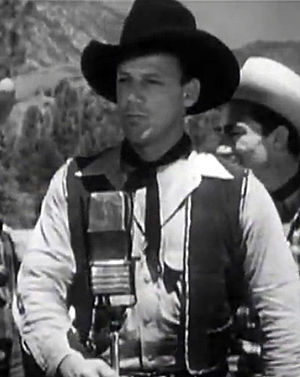 Bob Nolan - Bob Nolan in Lights of Old Santa Fe (1944)