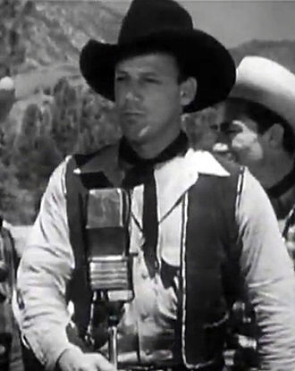 Bob Nolan - Bob Nolan in Lights of Old Santa Fe (1944)