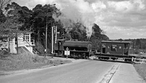 Bordon - Longmoor Military Railway crossing road at Bordon, 1963
