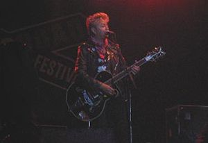 Stray Cats - Brian Setzer at a concert.