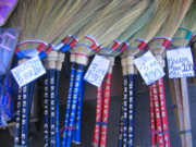 Brooms with price tags being sold in market