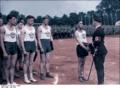 Bundesarchiv Bild 183-H29080, Lübeck, Himmler überreicht Sportpreis Recolored.png