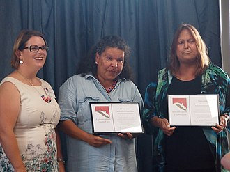 Conservation Council of South Australia - DEWNR CEO Sandy Pitcher presenting the CCSA's 2015 Jill Hudson Award to sisters Karina and Rose Lester for their work in advocating on behalf of aboriginal communities in relation to the SA Royal Commission into the Nuclear Fuel Cycle, 17 December 2015.