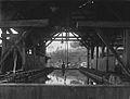 COLLECTIE TROPENMUSEUM Vacuümfilter in een loods bij de Mijnbouw Maatschappij Redjang Lebong te Lebong Donok TMnr 60023040.jpg