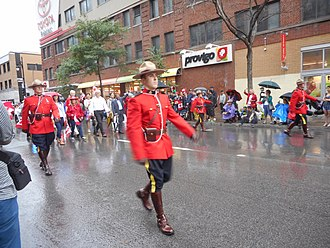 Royal Canadian Mounted Police - RCMP in dress uniform Canada Day 2015 on Saint Catherine Street - 063