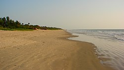 The beach stretching south towards the border to Guinea-Bissau