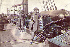 Raphael Semmes - Captain Raphael Semmes standing by his ship's 110-pounder rifled cannon and his executive officer, 1st Lieutenant John McIntosh Kell, standing by the ship's wheel.