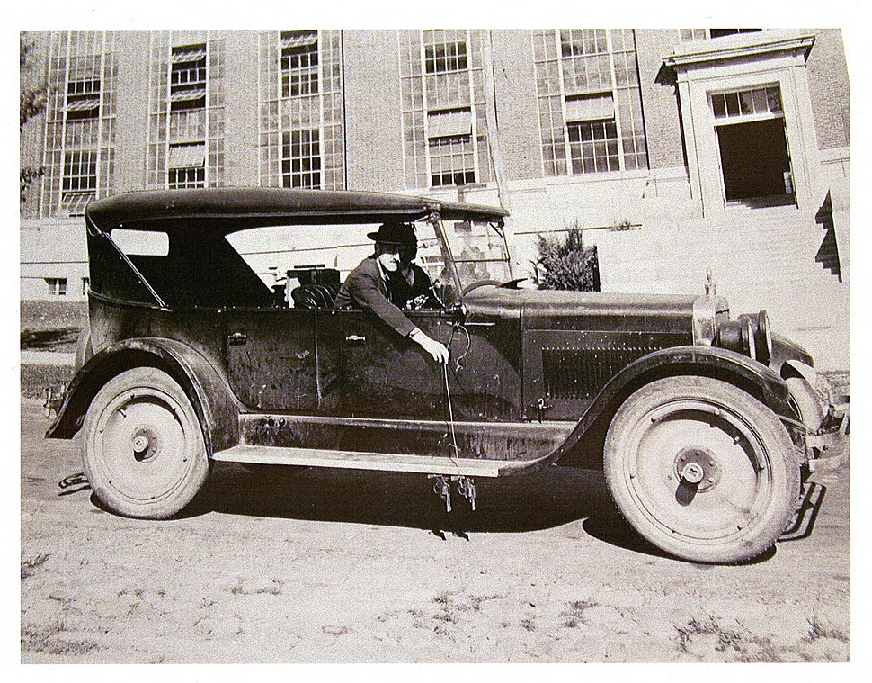 Car rigged with two pistols to measure a Bureau motorist's reaction time in applying his brakes