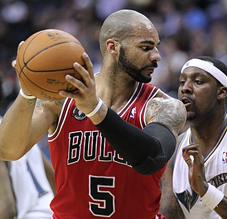 Carlos Boozer - Boozer posting up Andray Blatche in a game for the Bulls in 2011.
