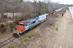 Carolina Coastal Railway - A four-engine consist of the Carolina Coastal Railway (CLNA) hauls 30 cars of freight across the Neuse River on the way to Raleigh, NC from Wilson, NC.