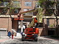 Cherry picker in pedestian courtyard SW of Sherbourne and Front, 2015 05 22 (4) (17826236219).jpg