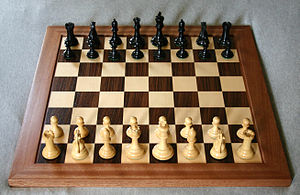 Chessboard with Staunton chess pieces.