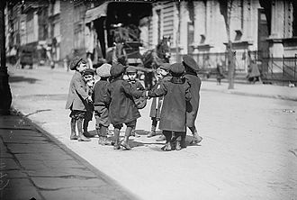 Children's street culture - Young boys playing in a New York City street, 1909
