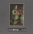 Chinese child with fan, standing next to vase (NYPL Hades-2359306-4043662).tiff
