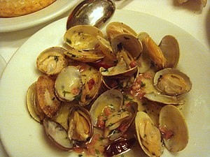 Cooked clams on a plate.