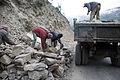 Clearing rocks after a landslide (3803032169).jpg