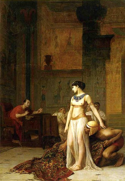 Cleopatra Before Caesar by Jean-Léon Gérôme, oil on canvas, 1866. Cleopatra confronts Gaius Julius Caesar after emerging from a roll of carpet. The Egyptian Queen had been driven from the palace in Alexandria by her brother/husband Ptolemy XIII. She had to disguise herself to regain entry and treat with Caesar for protection and restoration of her throne.