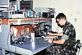 Colonel Thompson of the Aircraft Intermediate Maintenance Department (AIMD) Precision Measuring Equipment (PME) section uses a variety of electronic diagnostic equipment to repair a - DPLA - 3e590ccd48dc751cfbdc782f2b45a379.jpeg