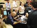 Comic-Con 2010 - Frank Darabont and Drew Struzan sign the limited edition Walking Dead poster.jpg